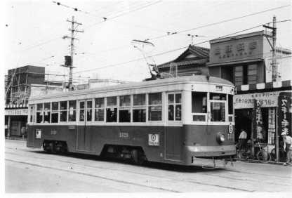 old tram stopping in the street 1475x1001