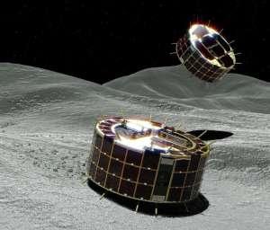 © Fournis par AFP Cette image de l'agence spatiale japonaise (JAXA) publiée par Jiji Press le 21 septembre 2018 montre les micro-robots qui vont se poser sur un astéroïde à 3 milliards de km de la Terre, pour tenter de mieux comprendre les origines de la vie